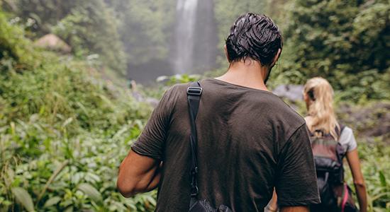 Man and woman navigating jungle