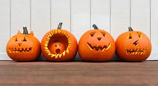 Row of Halloween jack-o-lanterns
