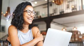 Woman in coffee shop on laptop