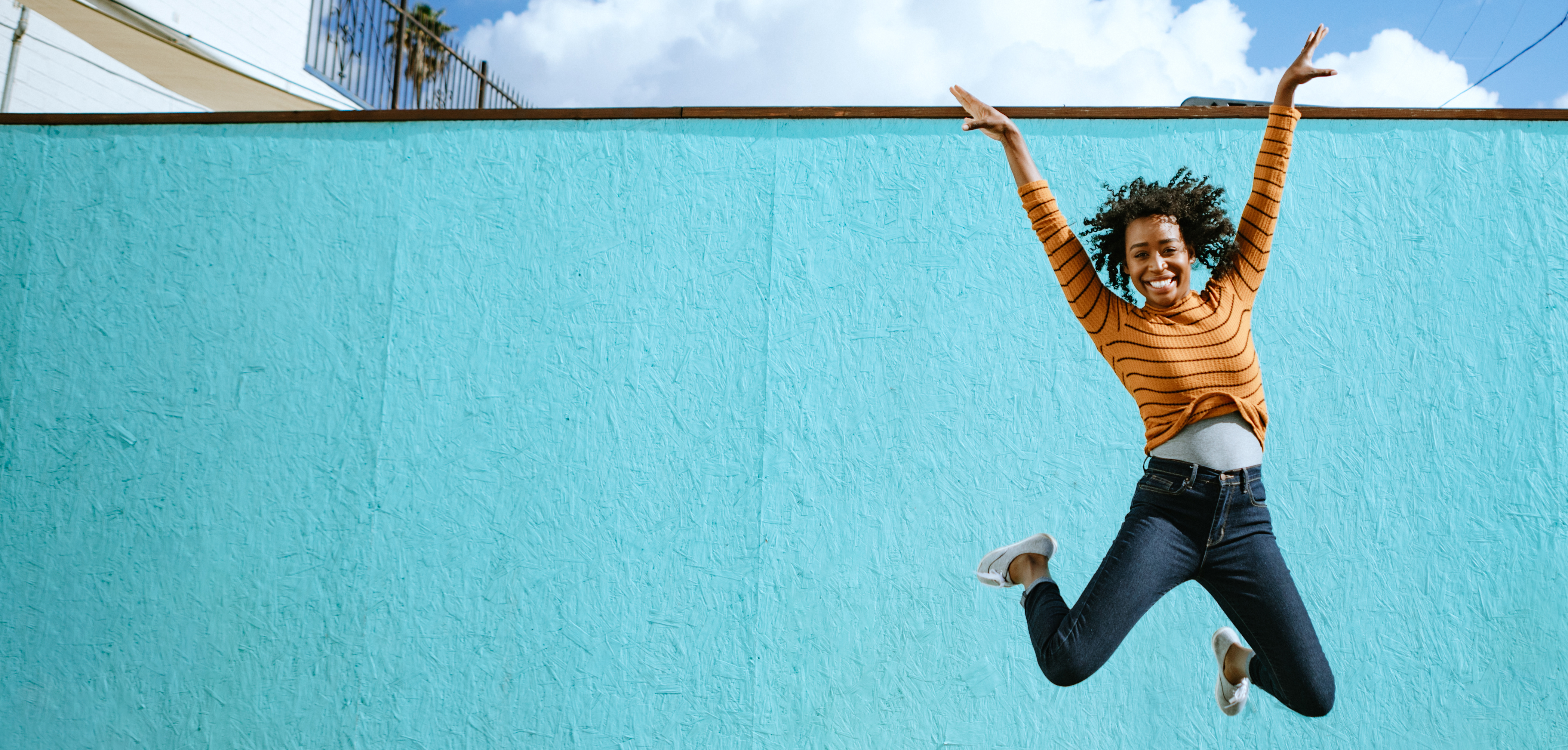 Woman jumping for joy outdoors
